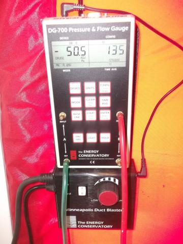 A manometer is used to measure pressure differentials between indoors and outdoors when testing whole-house air leakage.
