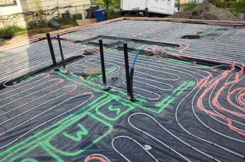PEX piping loops are laid before the slab is poured for this radiant floor heating system
