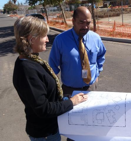 A developer meets with a landscape architect at the site.