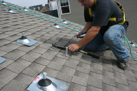 A roof mounting system for a PV system