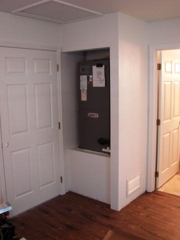 A high-efficiency heat pump is installed in a closet within this home's conditioned space.
