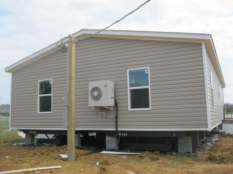 A single ductless heat pump heats and cools the country's first DOE Zero Energy Ready certified manufactured home.