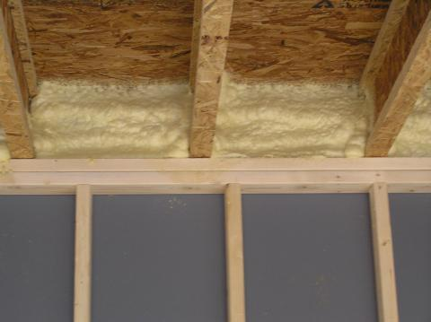 Spray foam insulates the rim joist and air seals the subfloor-rim joist and rim joist-top plate connections