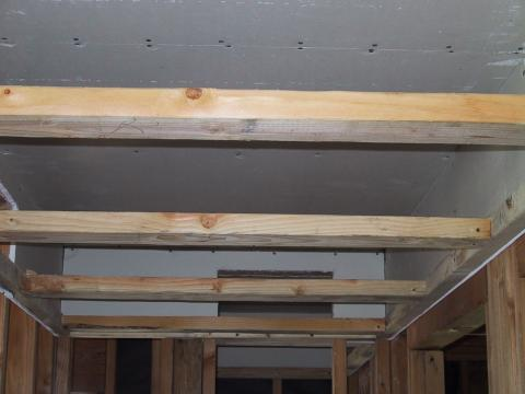 Dropped hallway ceiling duct chase with drywalled soffit