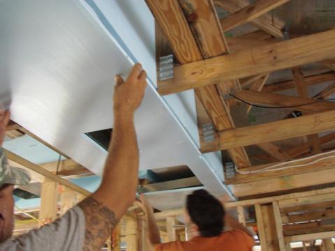 Install bottom layer of rigid insulation