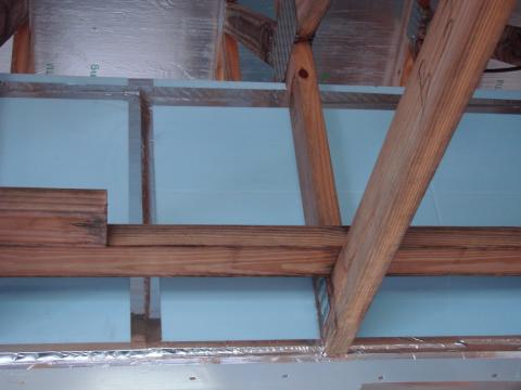 Seal bottom layer of rigid insulation with adhesive, tape and nails