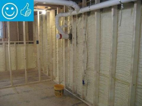 Right - Closed-cell spray foam covers the interior of the foundation wall and wall framing is placed to the inside of the spray foam