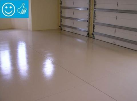 Right – The slab is coated with two coats of epoxy paint to minimize moisture transfer through the slab from the ground.