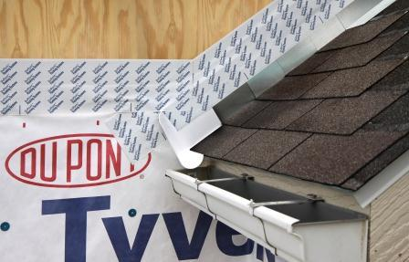 Apply self-adhesive flashing over top edge of the wall flashing, diverter, and housewrap