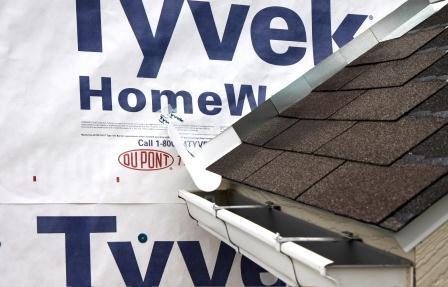 Install the housewrap. Cut housewrap to fit over diverter and tape top of cut
