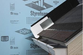 Step 3. Place the first shingle and the next section of sidewall flashing over upper edge of diverter
