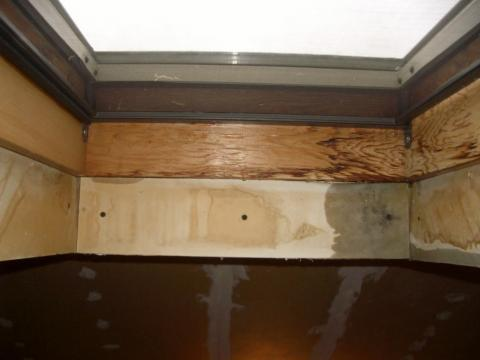 Water stains on the framing indicate water infiltration at the skylight