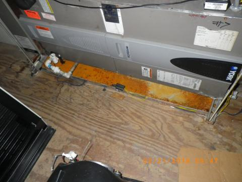 Metal drain pans under HVAC equipment can corrode over time, especially in humid environments