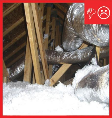 Wrong: Ducts are not laid across the lower truss cords or ceiling, but are hung from the rafters by straps. As a result, ductwork is not buried