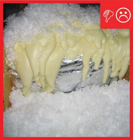 Wrong: Ductwork is not fully encapsulated with ccSPF insulation. The duct jacket is still fully visible at sections of the duct