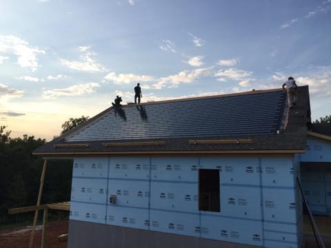 The 6 kW of solar panels consists of a solar shingle product that is similar in size to asphalt shingles and is integrated into the roof to provide most of the home's power needs.