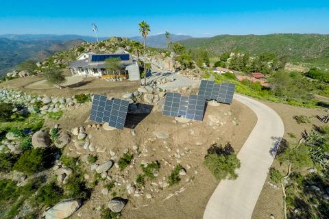 Renewable resources on this self-sufficient home include 22 kW of sun-tracking photovoltaic panels, a 3.2-kW wind mill, batteries for power storage, a solar thermal water heating system, and nine 10,000-gallon water tanks.