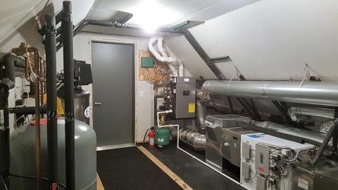 This utility room houses a high-efficiency gas boiler to provide hot water for the radiant floor heating system and faucets. It also has a central air source heat pump and an energy recovery ventilator.
