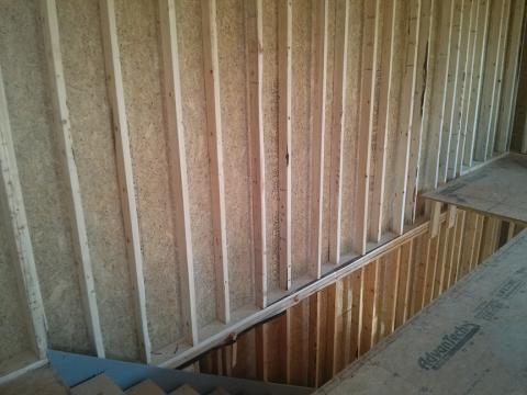 The basement is half in and half out of the ground with only 4 feet below grade, which allows for full 36-inch-tall windows that are completely above grade.