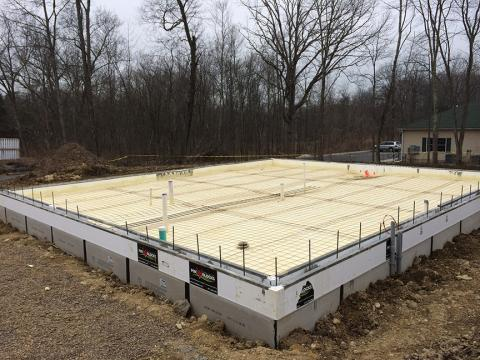 ICF foundation walls wrap the floor slab in R-22 of insulation while the entire space under the slab is covered with 4.3 inches of closed-cell spray foam.