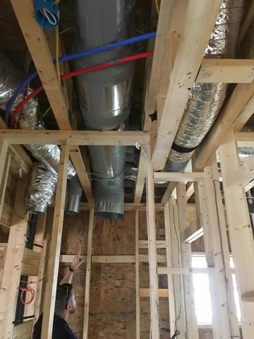 All of the ductwork for the efficient (8.5 HSPF, 15 SEER) heat pump is mastic sealed and installed in conditioned space.