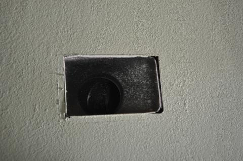 Air seal duct boot to ceiling by installing fiberglass mesh tape and mastic over seam