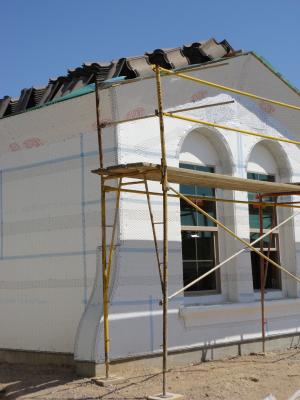 Expanded polystyrene insulation is installed with joints taped and lath attached in preparation for the application of stucco
