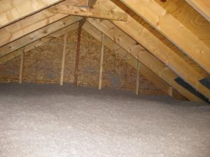 Blown insulation is added to the attic floor