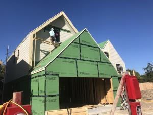 Right – The seams are taped on the coated OSB sheathing of this home to provide a complete air barrier.
