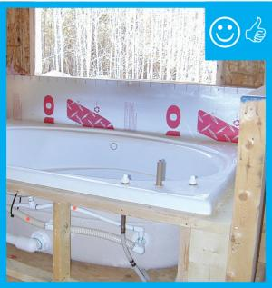 Right – Air barrier installed behind the tub