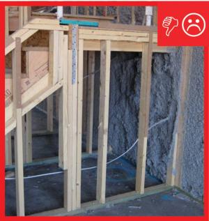 Wrong –  No air barrier installed under staircase