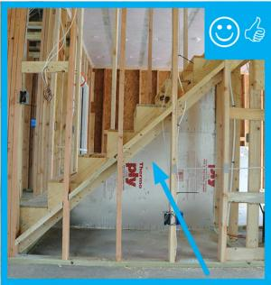 Right – Air barrier installed under staircase (picture taken from house looking into attached garage)