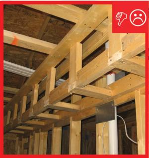 Wrong – No air barrier is present between the dropped ceiling/soffit and the attic