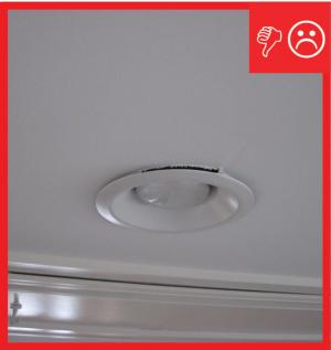 Wrong – Recessed can light has not been sealed to drywall