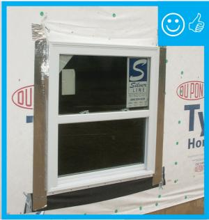 Right – There is flashing installed along the top of the window and the water-resistant barrier is layered over to create a complete drainage system