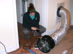 An energy rater uses a duct blower to test HVAC duct air leakage.