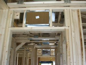 Right – Transfer grilles are installed over doorways to bedrooms in a new-construction home