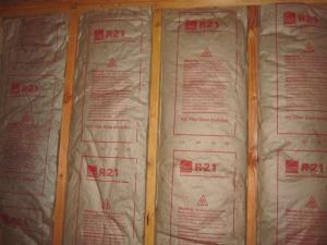 Faced fiberglass batt insulation can be stapled to the for Fiberglass batt insulation r value