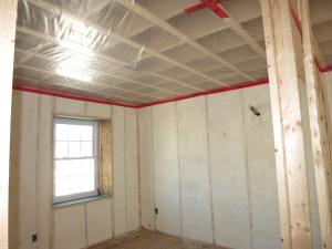 Right – Open-cell spray foam fills the cavity in this these double-stud walls