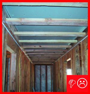 Wrong: Drywall does not extend beyond chase wall framing and is unsealed in a hallway dropped ceiling chase
