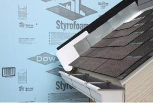 Step and kickout flashing should be installed at all roof-wall intersections to protect the wall and divert rainwater runoff into a gutter.