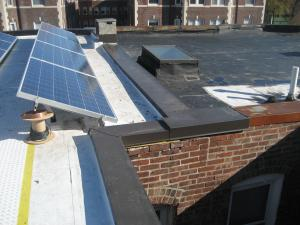 Metal Cap Flashing Is Installed Over The Roof Parapet And