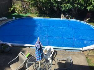 Pool covers minimize evaporation and heat loss from swimming pools.